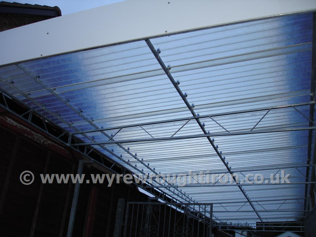 Photo - Detail of carport in Fleetwood showing steel structure and near transparent fibreglass roof