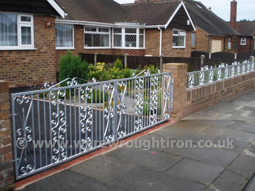Photo - Double flat top gates with top scrolls and galvanised finish, Thornton-Cleveleys