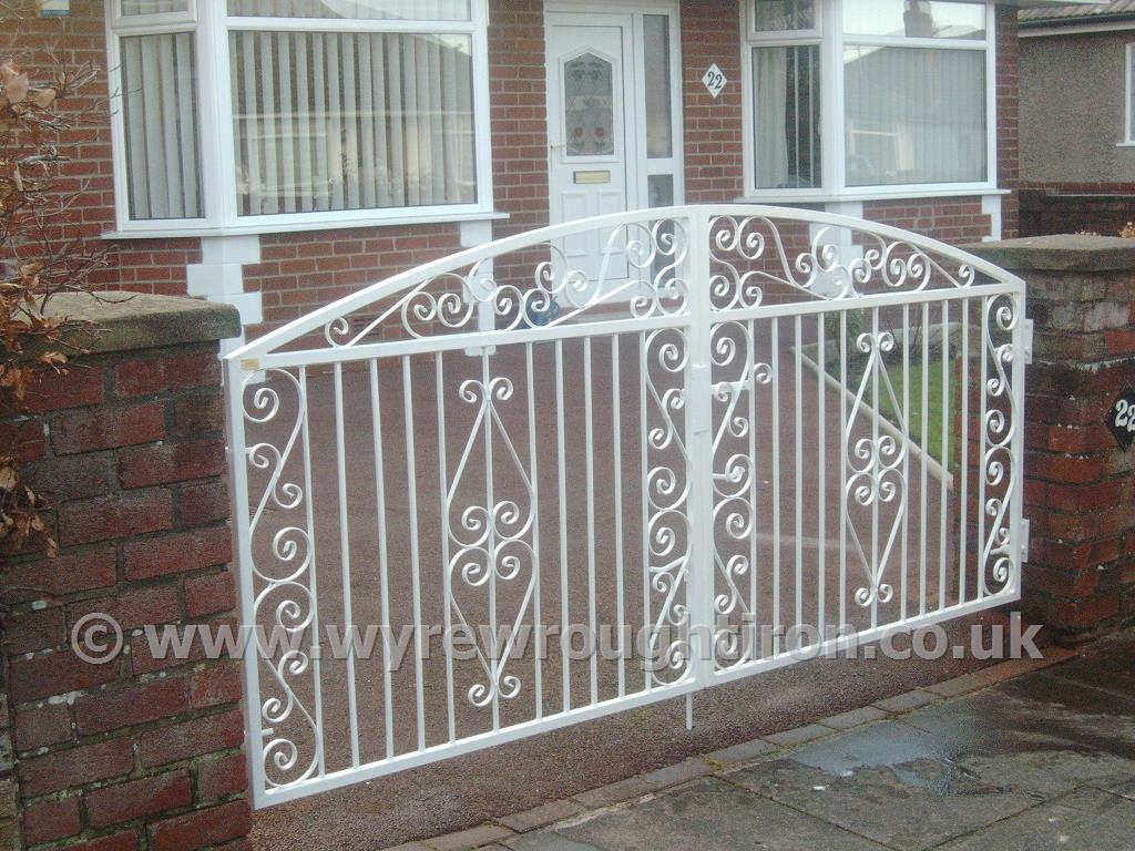 Double arch driveway gates in Thames design with white powder coated finish. Fitted to garden in Bispham, Blackpool