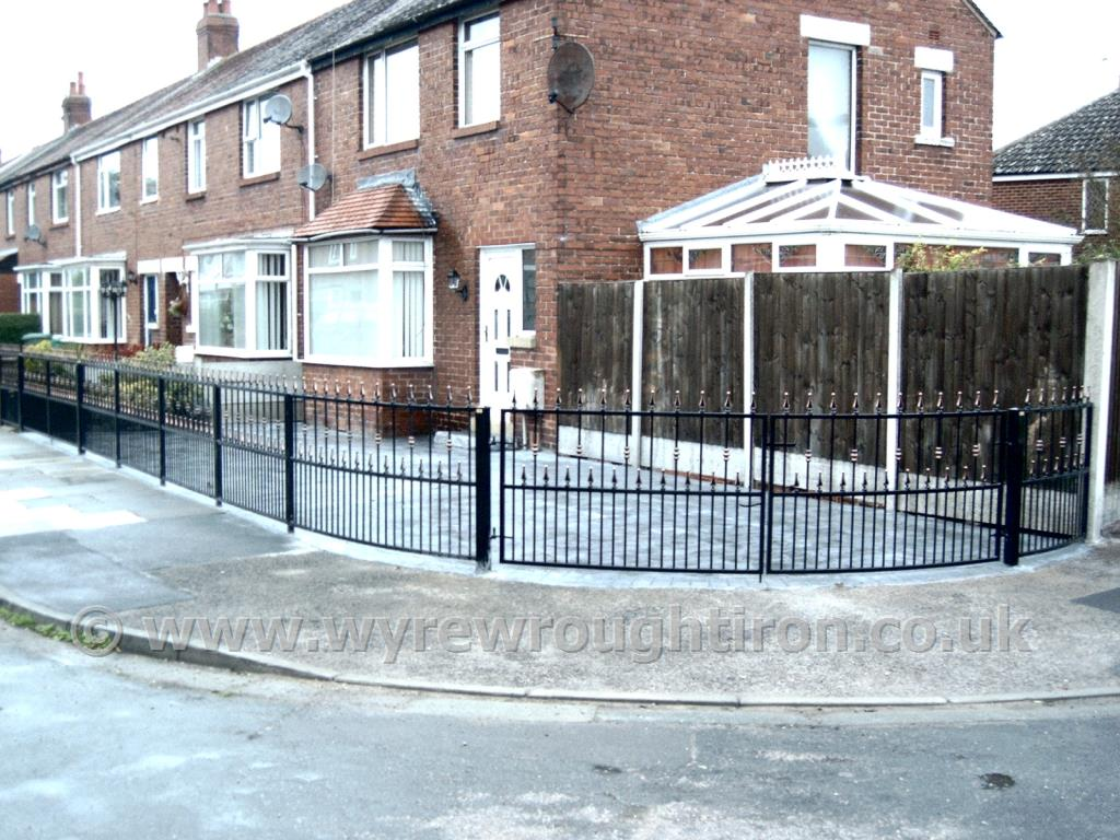 Curved gates and matching railings with flat top, railheads and barrels, black powder coated finish and gold detailing for Thornton customer.