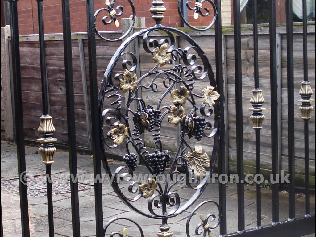 Detail of bespoke design for single driveway gate in Cleveleys, near Blackpool. Features intricate grapevine centrepiece with hand painted finishing.