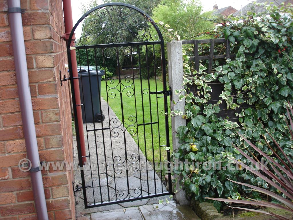 Tall single rear garden gate in C Scroll design with black powder coated finish. Completed for customer in Wrea Green, near Kirkham.