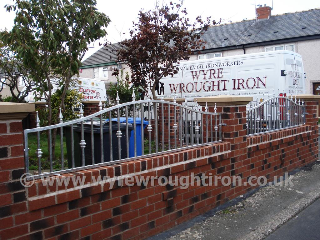 Arch garden wall railings with railhead, bush detail and galvanised finish for Fleetwood garden.