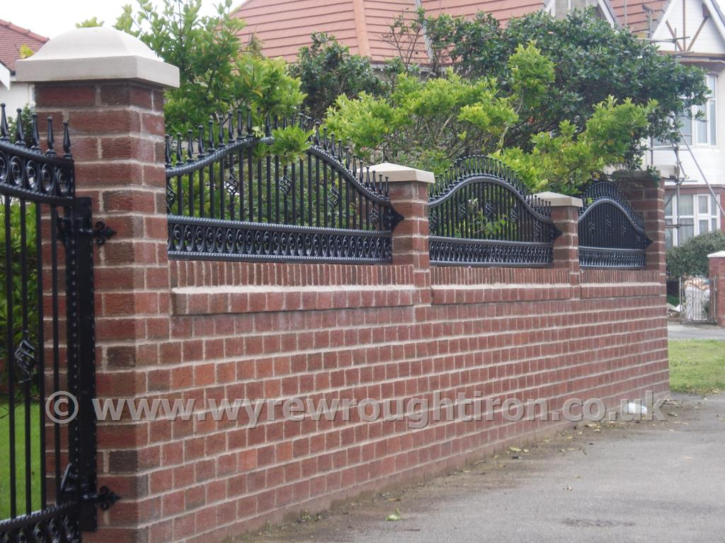 Photo - Black arched top railings with railheads and scrolled tail circles, Thornton-Cleveleys